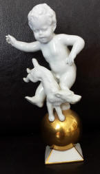 #5185 cherub and dog atop gold ball