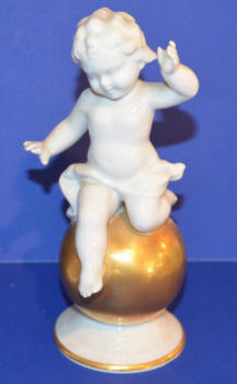 Cherub Sitting on Gold Ball